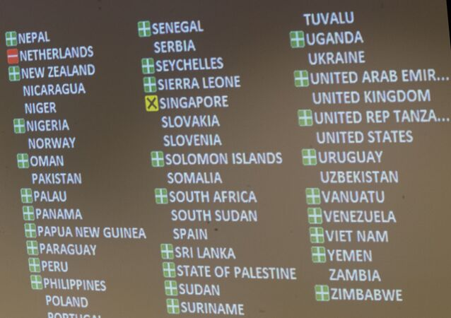 A detail of the video board showing the votes in favor, against and the abstention is seen after a vote by the conference to adopt a legally binding instrument to prohibit nuclear weapons, leading towards their total elimination, Friday, July 7, 2017 at United Nations headquarters.