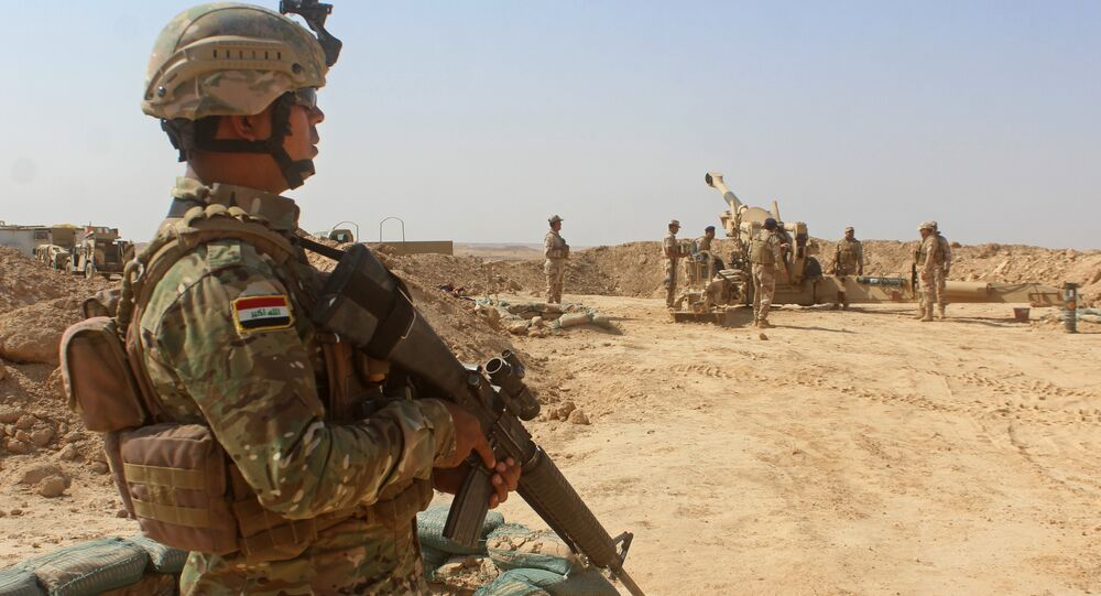 Iraqi forces fire preliminary shells from the area of al-Sakrah, as they prepare a military operation to push out Islamic State (IS) group jihadists from the nearby village of Anah in the northwestern Anbar province