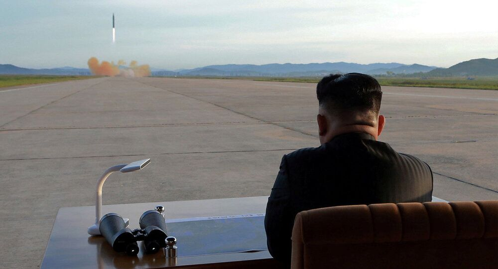 North Korean leader Kim Jong Un watches the launch of a Hwasong-12 missile in this undated photo released by North Korea's Korean Central News Agency (KCNA) on September 16, 2017