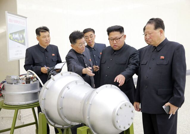 This undated file photo distributed on Sunday, Sept. 3, 2017, by the North Korean government, shows North Korean leader Kim Jong Un, second from right, at an undisclosed location in North Korea