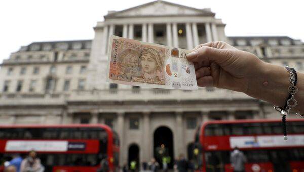 One of the new British 10 pound notes is posed for photographs outside the Bank of England in the City of London, Thursday, Sept. 14, 2017. - Sputnik International