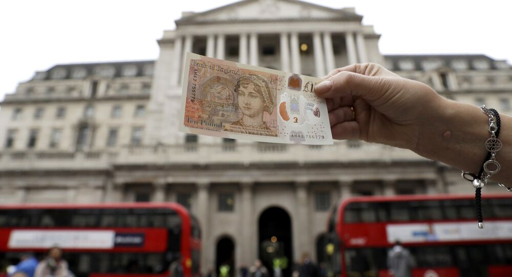 One of the new British 10 pound notes is posed for photographs outside the Bank of England in the City of London, Thursday, Sept. 14, 2017.
