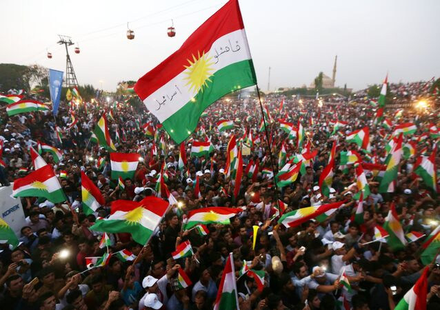 Iraqi Kurds fly Kurdish flags during an event to urge people to vote in the upcoming independence referendum in Arbil, the capital of the autonomous Kurdish region of northern Iraq, on September 16, 2017