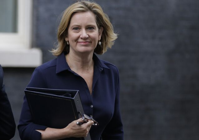 Britain's Home Secretary Amber Rudd looks at the media as she arrives for a Cabinet meeting at 10 Downing Street, in London, Thursday, Sept. 21, 2017.