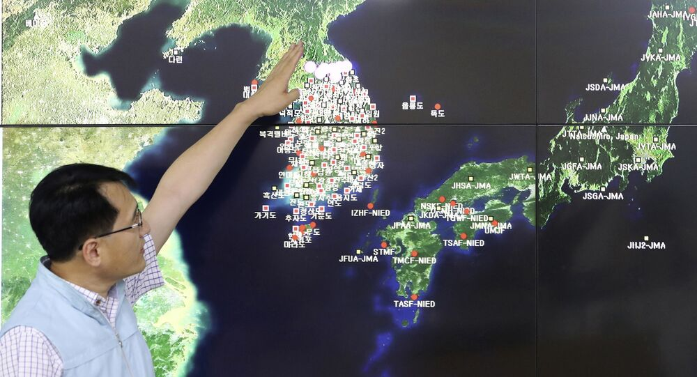 In this Sept. 3, 2017, file photo, Earthquake and Volcano of the Korea Monitoring Division Director Ryoo Yong-gyu speaks to the media about North Korea's artificial earthquake with a map of the Korean peninsular in Seoul, South Korea