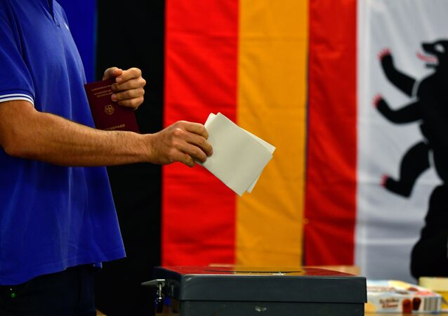A man casts his ballot at a polling station in Berlin during general elections on September 24, 2017