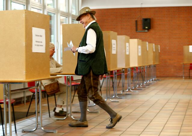 A man in traditional Bavarian costume votes in the general election (Bundestagswahl) in Munich, Germany, September 24, 2017