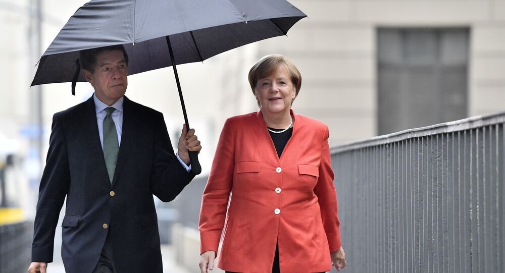 German Chancellor Angela Merkel, right, and her husband Joachim Sauer arrive to cast their vote in Berlin, Germany, Sunday, Sept. 24, 2017