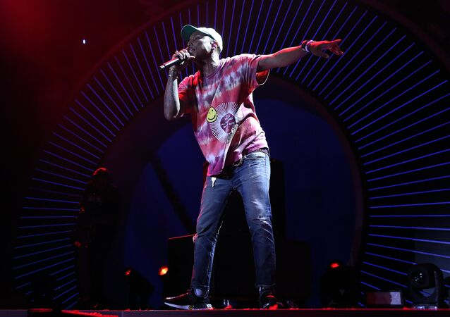 (File) Pharrell Williams performs on stage performs on stage during the Global Citizen Festival G20 benefit concert at the Barclaycard Arena in Hamburg, northern Germany on July 6, 2017 on the eve of the G20 summit