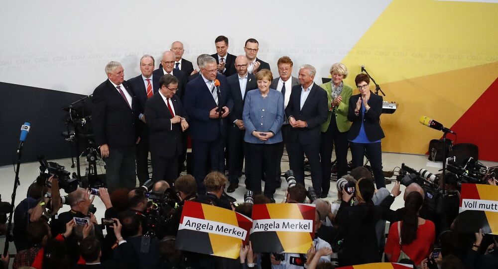 Christian Democratic Union CDU party leader and German Chancellor Angela Merkel reacts is congratulated by members of her party during the German general election (Bundestagswahl) in Berlin, Germany, September 24, 2017
