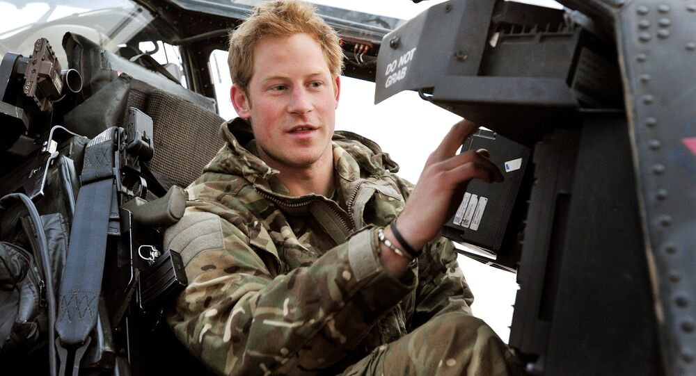 In this photo taken Dec. 12, 2012, made available Monday Jan. 21, 2013 of Britain's Prince Harry or just plain Captain Wales as he is known in the British Army, makes his early morning pre-flight checks on the flight-line, from Camp Bastion southern Afghanistan.