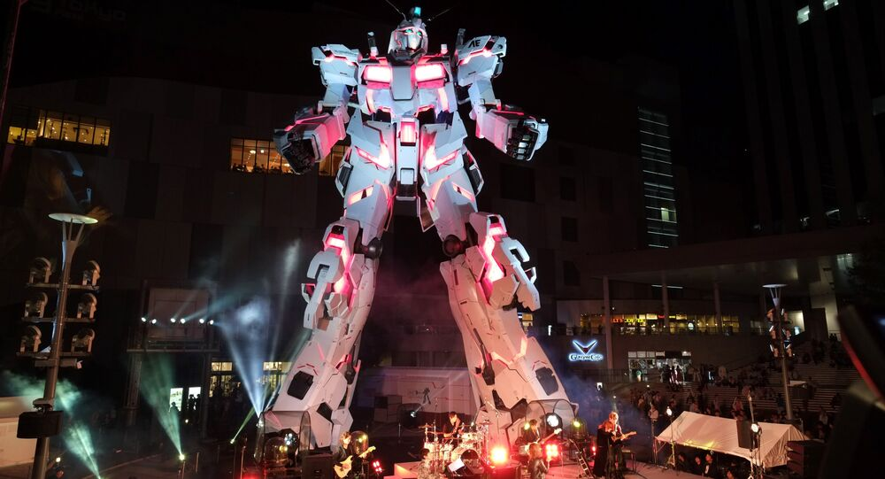 The new full-size standing statue RX-0 Unicorn Gundam from the Mobile Suit Gundam UC anime is unveiled at a press preview in Tokyo
