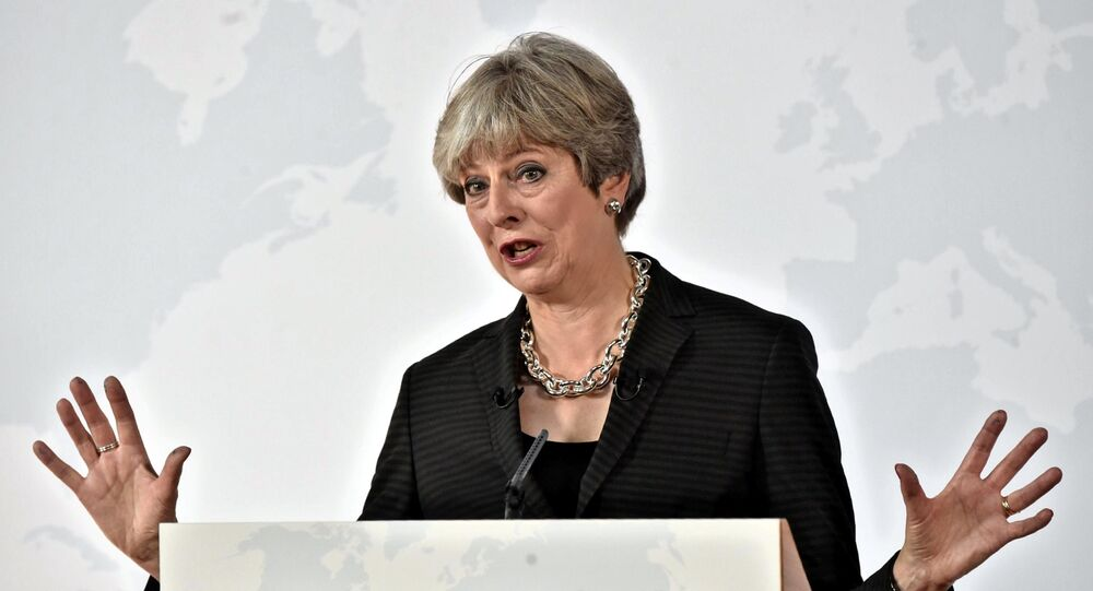 British Prime Minister Theresa May gestures as she delivers her speech in Florence, Italy September 22, 2017