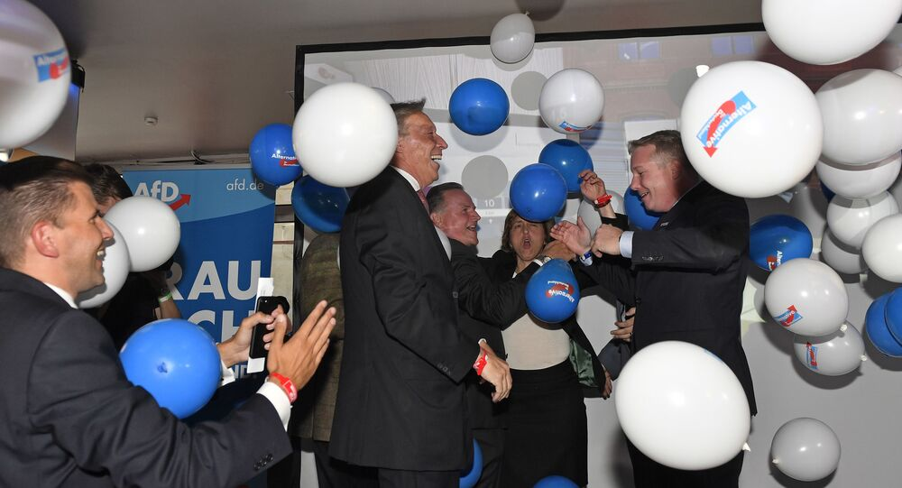 AfD board members celebrate with balloons during the election party of the nationalist 'Alternative for Germany', AfD, in Berlin, Germany, Sunday, Sept. 24, 2017, after the polling stations for the German parliament elections had been closed.