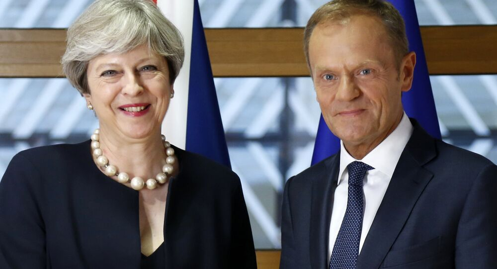 European Council President Donald Tusk, right, poses for photographers with British Prime Minister Theresa May prior to a bilateral meeting on the sidelines of an EU summit in Brussels on Thursday, June 22, 2017.