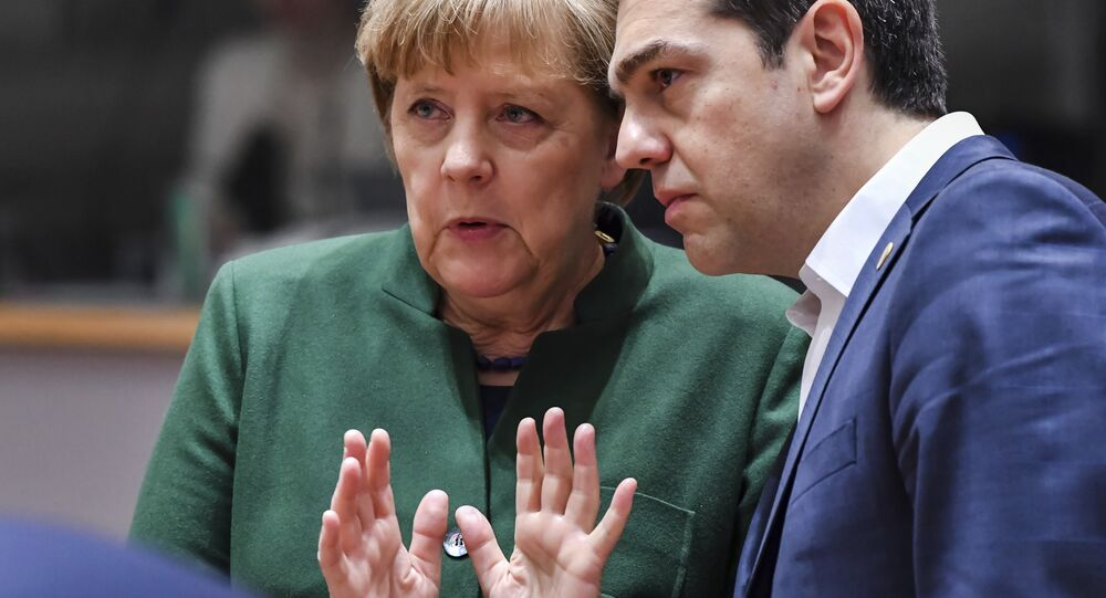 Greek Prime Minister Alexis Tsipras, right, speaks with German Chancellor Angela Merkel during a round table meeting at an EU summit in Brussels on Friday, March 10, 2017.