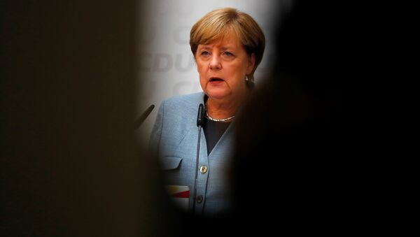 Christian Democratic Union CDU party leader and German Chancellor Angela Merkel reacts during a news conference at the CDU party headquarters, a day after the general election (Bundestagswahl) in Berlin, Germany September 25, 2017. - Sputnik International