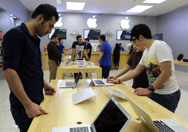 People shop at a store selling Apple products in the north of the Iranian capital Tehran. (File)