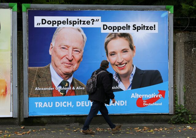 A man looks at at a placard of Alexander Gauland and Alice Weidel, the top candidates of Germany's anti-immigration party Alternative fuer Deutschland AfD for the September 24 federal election, in Marxloh, a suburb of Duisburg which local media said is populated mostly with people of Turkish migrant background, Germany September 13, 2017