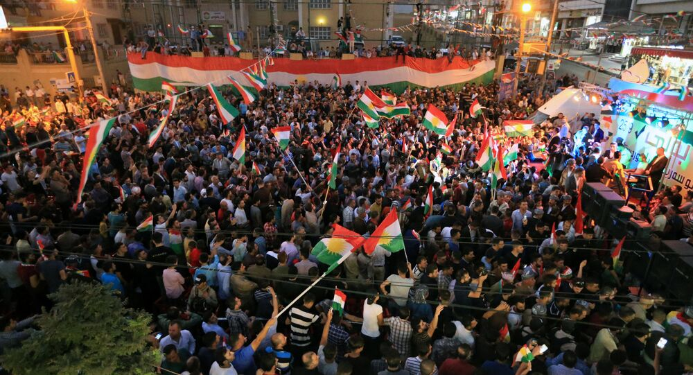 Kurds celebrate to show their support for the independence referendum in Duhok, Iraq