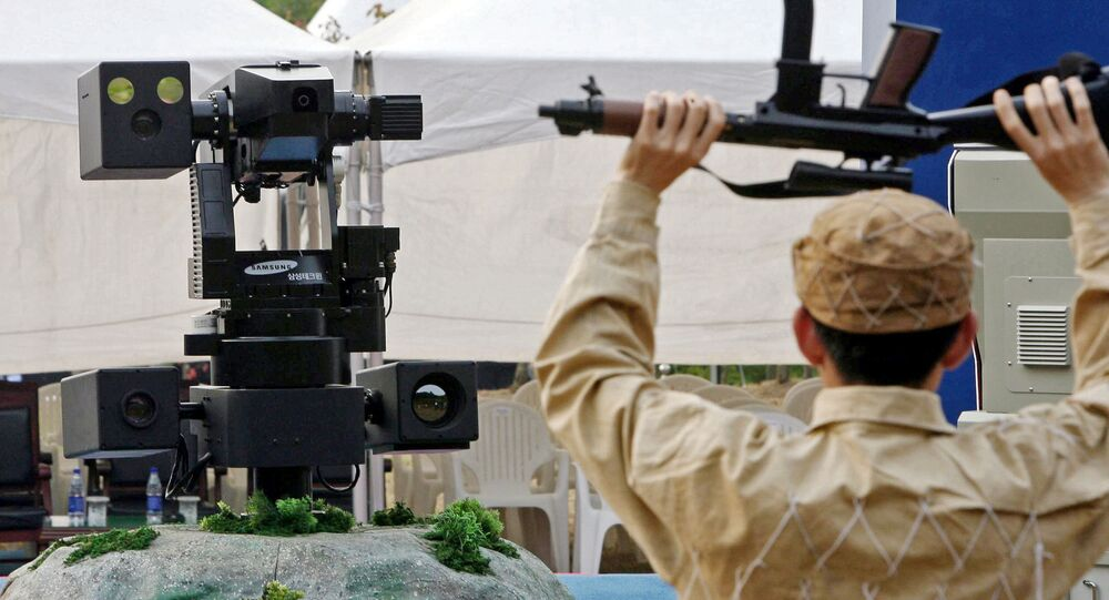 A sentry robot freezes a hypothetical intruder by pointing its machine gun during its test. (File)