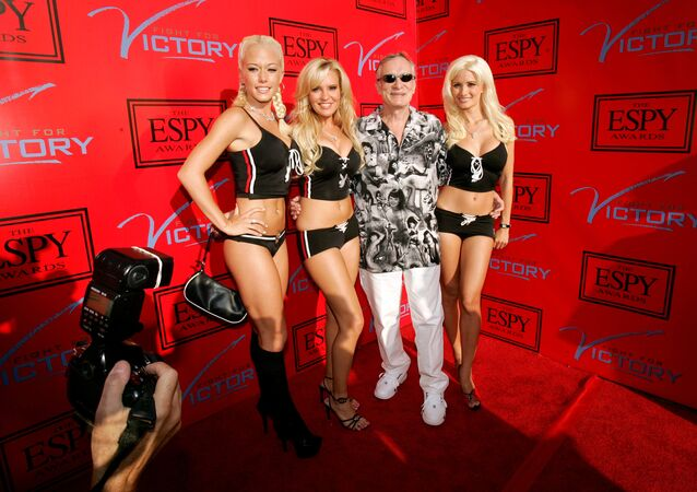 Playboy magazine founder Hugh Hefner (C) arrives with friends for an ESPY Awards pre-party at the Playboy Mansion in Beverly Hills, California. (File)