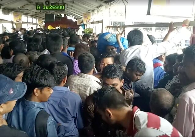 Crowds of commuters are seen moving along the Elphinstone railway station bridge around the time of a stampede, in Mumbai, India