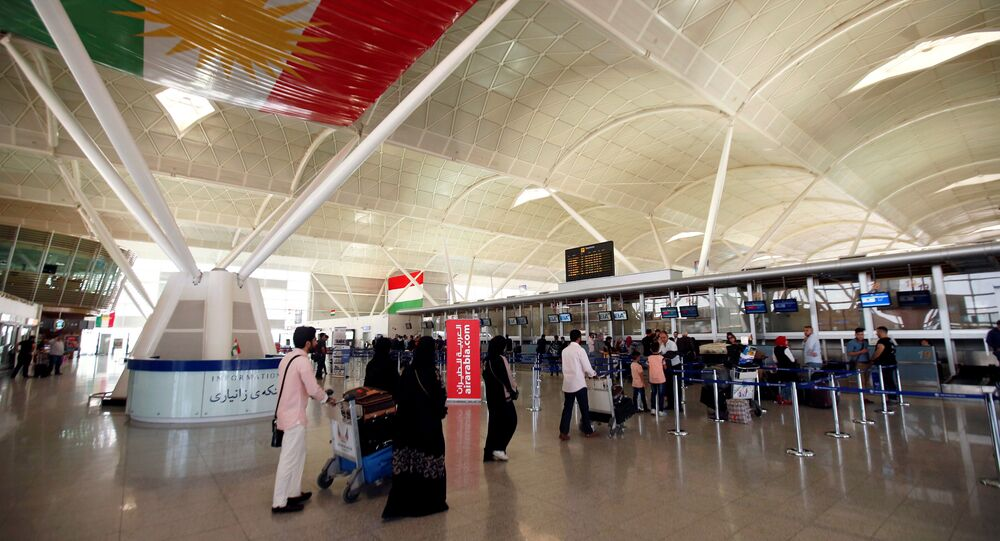 Passengers walk towards the check-in counters at Erbil International Airport, Iraq September 27, 2017