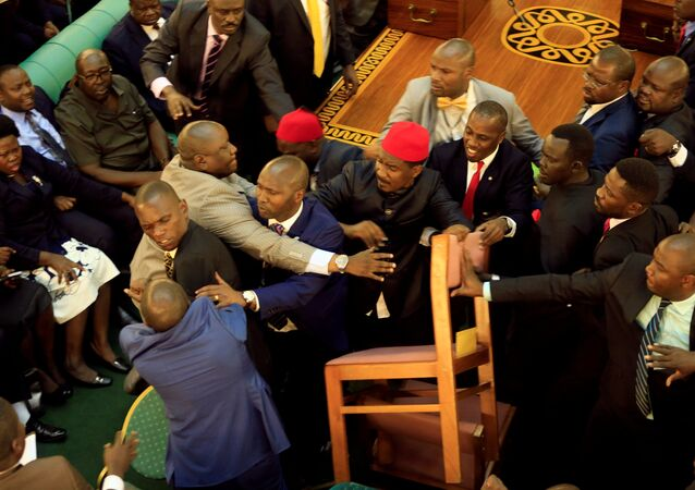Ugandan lawmakers involve in a fight in the parliament ahead of proposed age limit amendment bill debate a move to change the constitution to extend the president's rule, in Kampala, Uganda September 26, 2017.