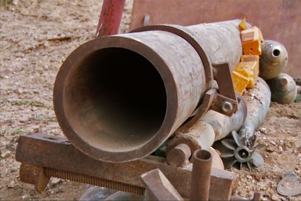 A mortar launcher and mines in the city of Deir ez-Zor