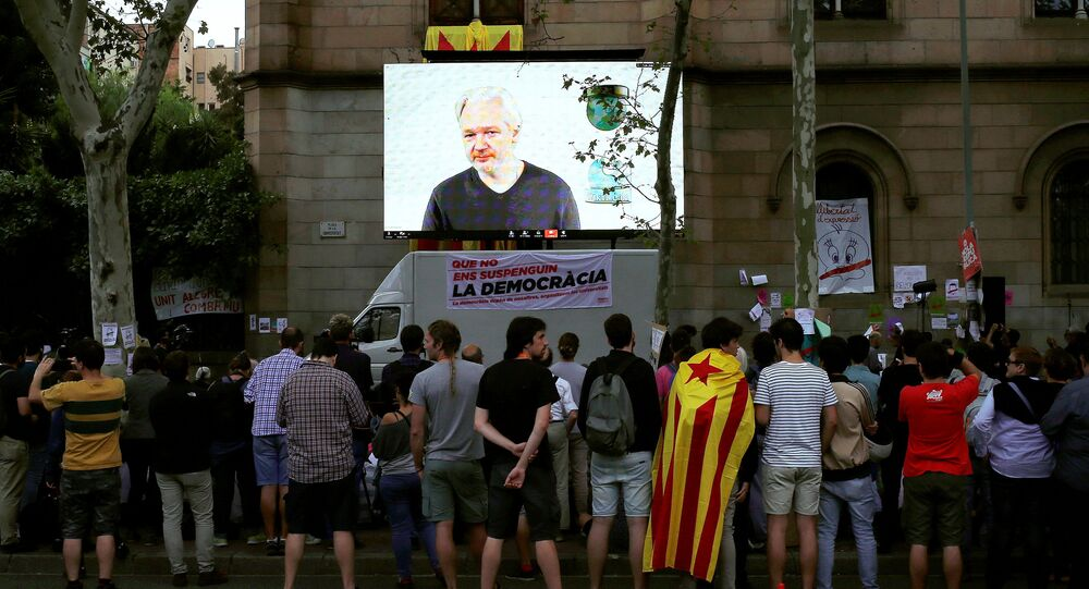 WikiLeaks founder Julian Assange is seen on a screen during a live video conference for a colloquium with students and citizens as they protest in favour of the banned October 1 independence referendum, outside the University of Barcelona, in Barcelona, Spain, September 26, 2017