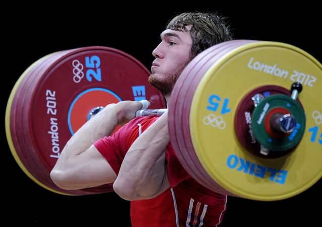 (File) Russia's Apti Aukhadov takes part in the men's 85 kg weightlifting event at the 30th Olympic Games in London