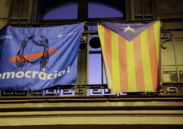 An agitation poster on a balcony in Barcelona which will host a referendum on Catalonia's independence from Spain