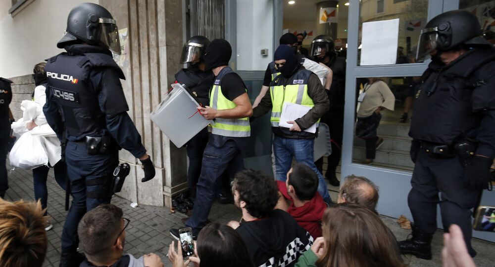 Spanish police seize ballot boxes in a polling station in Barcelona, on October 1, 2017, on the day of a referendum on independence for Catalonia banned by Madrid