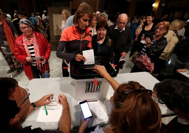 People cast their ballots at a polling station for the banned independence referendum in Barcelona, Spain October 1, 2017