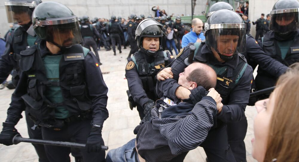 Spanish Guardia Civil guards drag a man outside a polling station in Sant Julia de Ramis, where Catalan president was supposed to vote, on October 1, 2017, on the day of a referendum on independence for Catalonia banned by Madrid