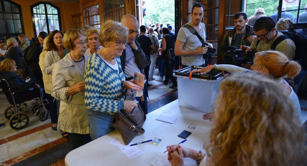 Voting at a polling station in Barcelona during a referendum on Catalonia's independence