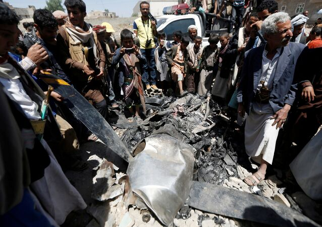 People gather around the engine of a drone aircraft which the Houthi rebels said they have downed in Sanaa, Yemen October 1, 2017