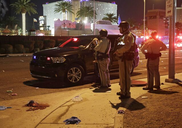 Police stand at the scene of a shooting along the Las Vegas Strip, Monday, Oct. 2, 2017, in Las Vegas