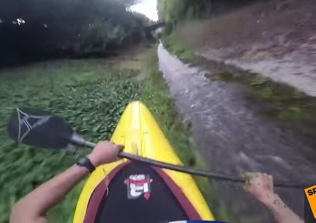 Adrenaline Junkies Kayaking Down Drainage Ditch
