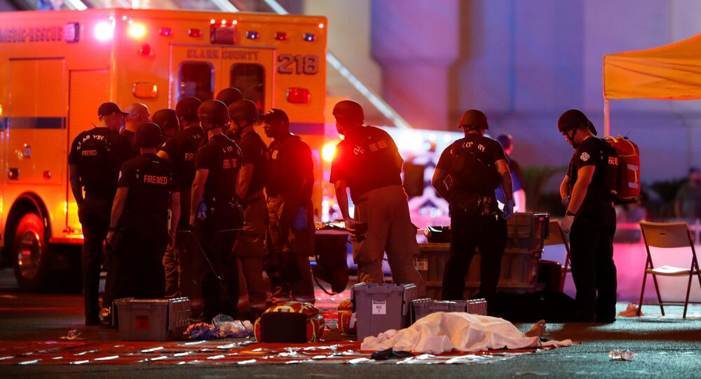 A body is covered with a sheet in the intersection of Tropicana Avenue and Las Vegas Boulevard South after a mass shooting at a music festival on the Las Vegas Strip in Las Vegas, Nevada, U.S. October 1, 2017