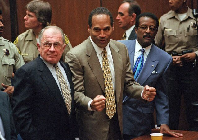 In this Oct. 3, 1995 file photo, O.J. Simpson, center, reacts as he is found not guilty of murdering his ex-wife Nicole Brown Simpson and her friend Ron Goldman, with attorneys F. Lee Bailey, left, and Johnnie Cochran Jr., right, in Los Angeles Superior Court