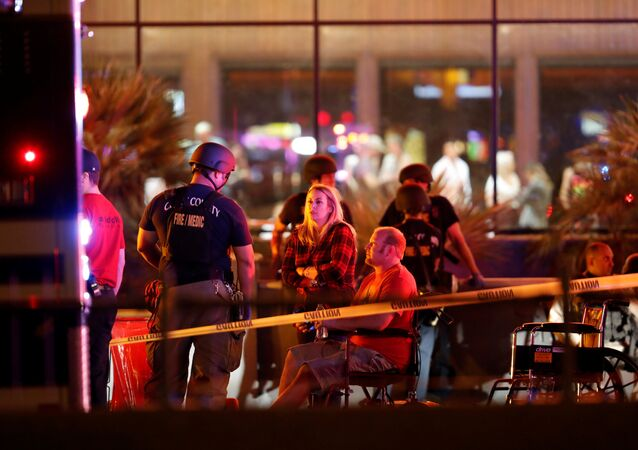 People wait in a medical staging area on October 2, 2017, after a mass shooting during a music festival in Las Vegas, Nevada, U.S