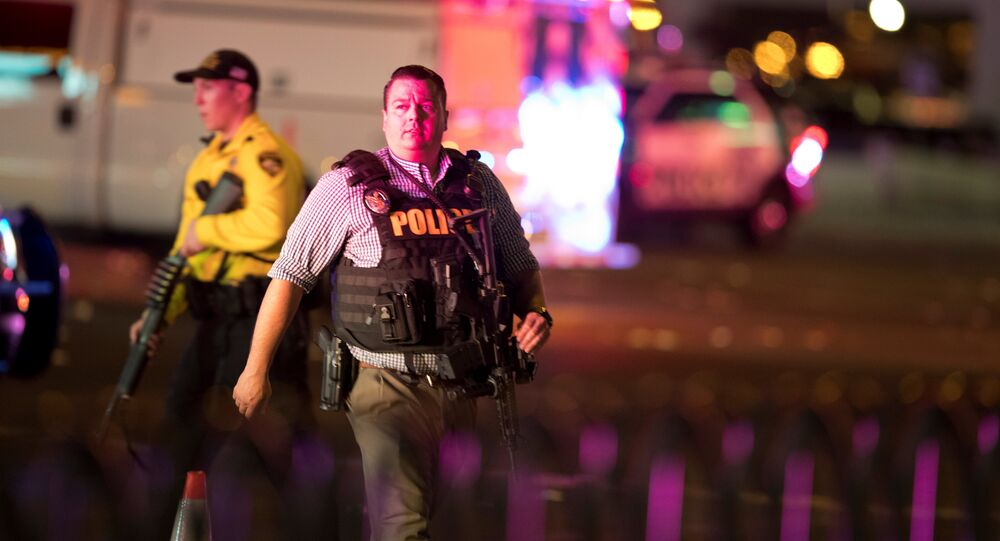 Law enforcement officers are shown on Las Vegas Boulevard South on October 2, 2017, after a mass shooting during a music festival in Las Vegas, Nevada, U.S.
