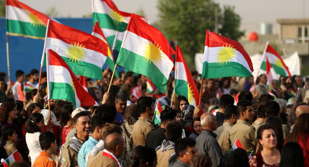 Iranian Kurds hold Kurdish flags as they take part in a gathering to urge people to vote in the independence referendum in the town of Bahirka, north of Arbil, the capital of the autonomous Kurdish region of northern Iraq.
