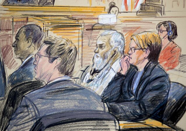 This courtroom sketch shows Ahmed Abu Khattala, third from right, listening to an interpreter through earphones during the opening statement by his defense attorney Jeffery Robinson in federal court in Washington Monday, Oct. 2, 2017. Khattala, the suspected mastermind of the 2012 attacks on a diplomatic compound in Benghazi, Libya, that killed four Americans, is on trial. Also depicted are members of the defense team Cole Lutermilch, left, and Michelle Peterson, second from right.