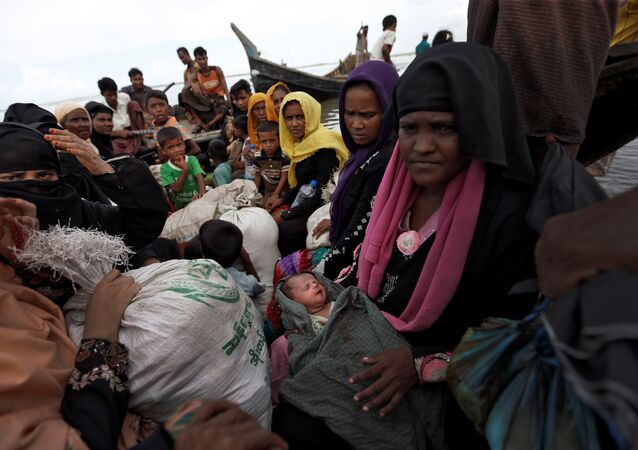 Newly arrived Rohingya refugees board a boat as they transfer to a camp in Cox's Bazar, Bangladesh, October 2, 2017