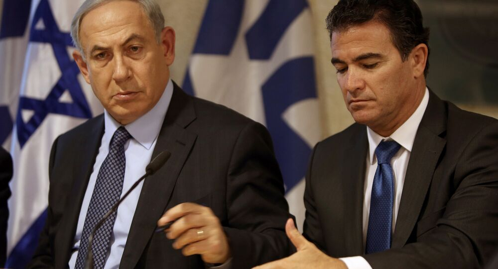 A file picture taken at the Israeli foreign ministry on October 15, 2015, shows Prime Minister Benjamin Netanyahu (L) sitting next to Yossi Cohen, head of the Mossad intelligence agency.