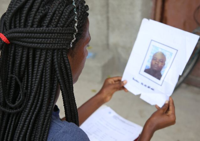 Jacquendia Cangé holds the photo of the UN Nigerian police officer, who she claims to have raped: I can never forgive, she says