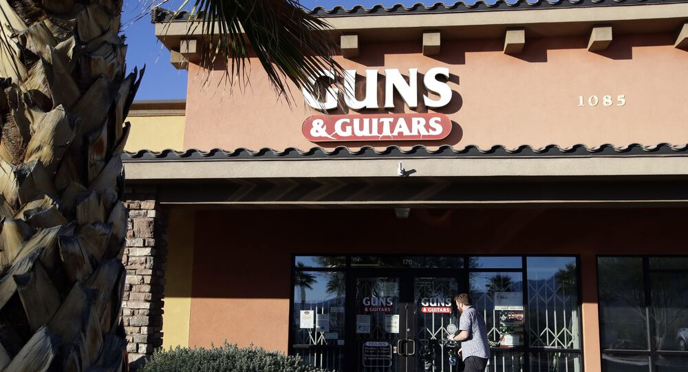 A member of the media takes video footage of the front of the Guns & Guitars store in Mesquite, Nev., Monday, Oct. 2, 2017